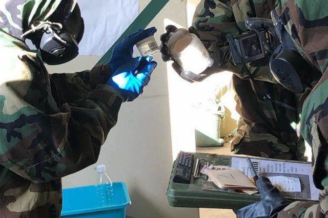 A sampling team composed of U.S. Army Soldiers from the 2d Cavalry Regiment and the 173rd Airborne Brigade conduct sampling operations while on the objective during the capstone mission of a joint chemical, biological, radiological and nuclear training exercise at the 7th Army Training Command's Grafenwoehr Training Area, Grafenwoehr, Germany, Feb. 25 - 28, 2019. The capstone event included a joint mission involving large terrain and roads for mounted reconnaissance and a village for the smaller, more acute dismounted reconnaissance operations. (U.S. Army photo by 1st Lt. Joshua Snell, 2d Cavalry Regiment)