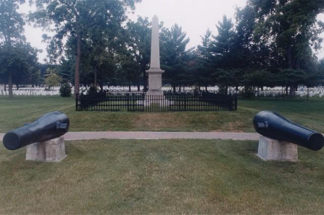 Three Rodman Guns flank the grave of its creator, Brigadier General Thomas J. Rodman, who is buried on Rock Island Arsenal.