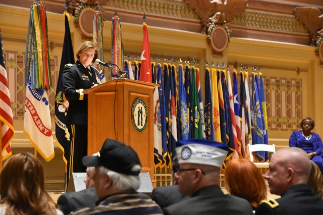 U.S. Army Lt. Gen. Laura J. Richardson, left, deputy commanding general of Forces Command, speaks April 5 in Pittsburgh's Soldiers and Sailors Memorial Hall and Museum, during the presentation of the Distinguished Service Cross to Freddie Jackson, right, the mother of U.S. Army Staff Sgt. Stevon A. Booker for his 2003 heroism while serving in Iraq. (U.S. Army photo by Paul Boyce, FORSCOM PAO)