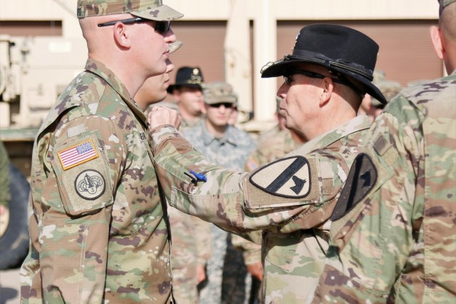 Col. Kevin Capra, commander of 3rd Armored Brigade Combat Team, 1st Cavalry Division, pins an Army Commendation Medal to Staff Sgt. Joseph Clinkenbeard in recognition of his actions following a traffic accident April 7. Staff Sgt. Joseph Clinkenbeard along with Spc. Nicholas Vanosdel, both of 3rd Battalion, 8th Cavalry Regiment, and Kim Black, a pediatric nurse and the wife of 3-8 Cav commander, Lt. Col. Kevin Black extracted and provided care to victims of a car rollover outside of Fort Hood.