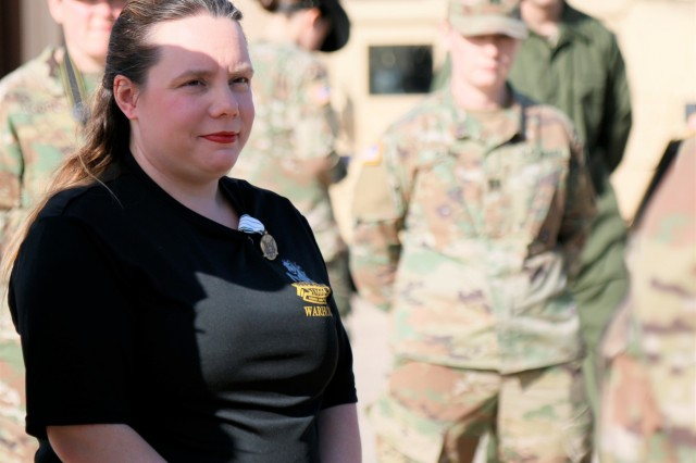 Kim Black, a pediatric nurse and wife of 3rd Battalion, 8th Cavalry Regiment, 3rd Armored Brigade Combat Team, 1st Cavalry Division commander, Lt. Col. Kevin Black, was recognized with the Civilian Service Commendation Medal  for her actions following a traffic accident April 7. Black, along with Staff Sgt. Joseph Clinkenbeard and Spc. Nicholas Vanosdel also from the Warhorse Battalion, extracted and provided care to victims of a car rollover outside of Fort Hood.