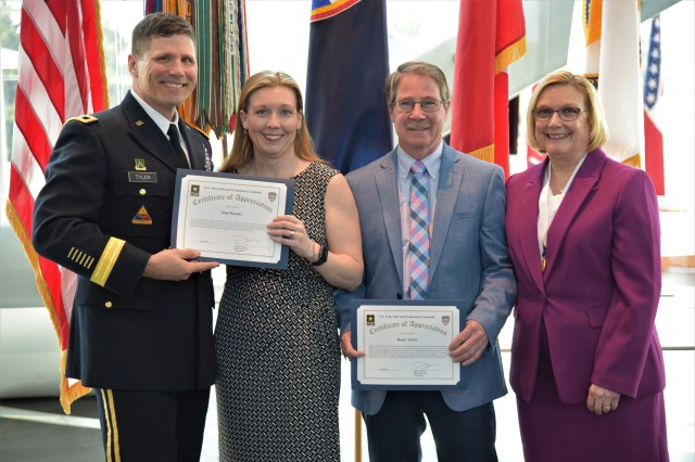 Maj. Gen. Joel K. Tyler, commander of the U.S. Army Test and Evaluation Command (ATEC), presents Karen L. Taylor's, former chief of staff of ATEC, daughter and husband with the Certificate of Appreciation Award during Taylor's retirement ceremony April 3. From L-R: Maj. Gen. Joel K. Tyler, Tami Hensley, Roger Taylor and Karen Taylor.