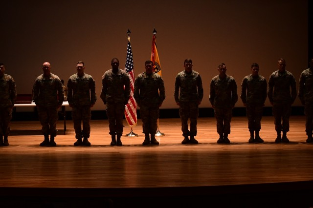 "'And the winners are-"" Ten competitors vying for the prestigious honor of Best Warrior stand at attention on the stage of Waybur Theater at Fort Knox prior to the three winners being named April 12, 2019."