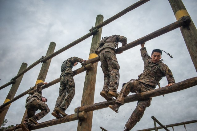"FORT BENNING, Ga. -- First Lt. Hong-Jun Moon, 3rd Infantry Division, descends the vertical ladder at Melvesti Field obstacle course. Arriving from U.S. Army units across the world and from one sister service, 54 two-man Ranger teams gathered before dawn April 12 at Camp Rogers here. The teams are competing over three days and two nights to earn the title of ""best ranger"" during the 36th David E. Granger Jr. Best Ranger Competition April 12 through 14 with an awards ceremony scheduled for April 15. (U.S. Army photo by Patrick Albright, Maneuver Center of Excellence, Fort Benning Public Affairs)"