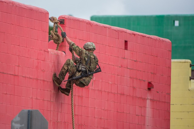 "FORT BENNING, Ga. -- A Ranger-qualified competitor rappels down a building at Selby Combined Arms Collective Training Facility during the urban assault course. Arriving from U.S. Army units across the world and from one sister service, 54 two-man Ranger teams gathered before dawn April 12 at Camp Rogers here. The teams are competing over three days and two nights to earn the title of ""best ranger"" during the 36th David E. Granger Jr. Best Ranger Competition April 12 through 14 with an awards ceremony scheduled for April 15. (U.S. Army photo by Patrick Albright, Maneuver Center of Excellence, Fort Benning Public Affairs)"