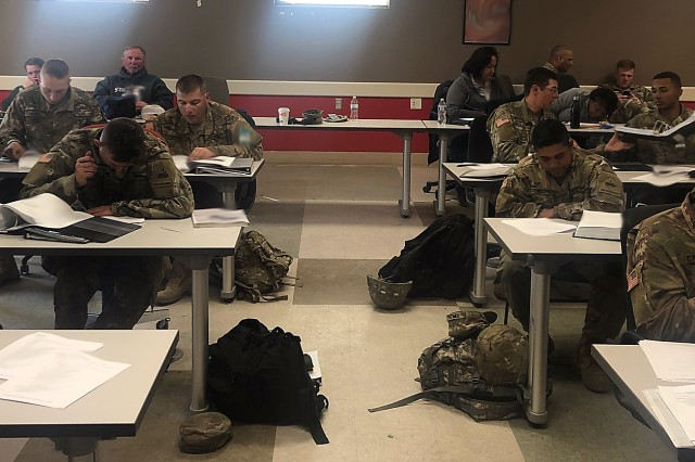 During operational testing, Engineer Soldiers from Alpha and Bravo Company, 40th Brigade Engineer Battalion (BEB), 2nd Armored Brigade Combat Team, 1st Armored Division at Fort Bliss, Texas, take written tests to qualify as Joint Assault Bridge (JAB) Operators and Crew Members during Operator New Equipment Training (OPNET).