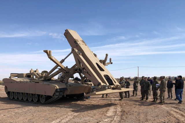 Engineer Soldiers from Alpha and Bravo Company, 40th Brigade Engineer Battalion (BEB), 2nd Armored Brigade Combat Team, 1st Armored Division at Fort Bliss, Texas, learn launch and recovery procedures without the bridge mechanism of the Joint Assault Bridge (JAB) during Operator New Equipment Training (OPNET) prior to operational testing.