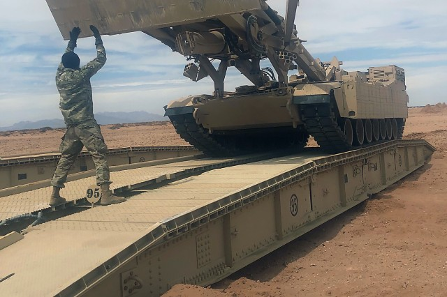 Engineer Soldiers from Alpha and Bravo Company, 40th Brigade Engineer Battalion (BEB), 2nd Armored Brigade Combat Team, 1st Armored Division at Fort Bliss, Texas, practice crossing over the bridge mechanism of the Joint Assault Bridge (JAB) prior to recovery operations during Operator New Equipment Training (OPNET).