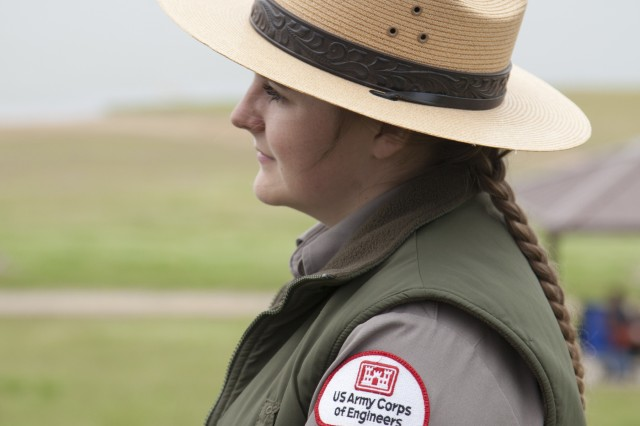 Student park ranger, Mylaina McMurray, observes a ranger educating school children about water safety at Black Butte Lake, Calif., on April 11, 2019. Warm weather at Northern California's 22 state parks, seven state wildlife areas and nine national forests is drawing an increased number of visitors to the areas, so the U.S. Army Corps of Engineers and Wilderness Inquiry volunteers teamed up to educate and train nearly 300 students from Orland's Fairview and Sierra View elementary schools. Students learned how to safely navigate waterways in canoes and save others from drowning. (U.S. Army photo by Ken Wright)