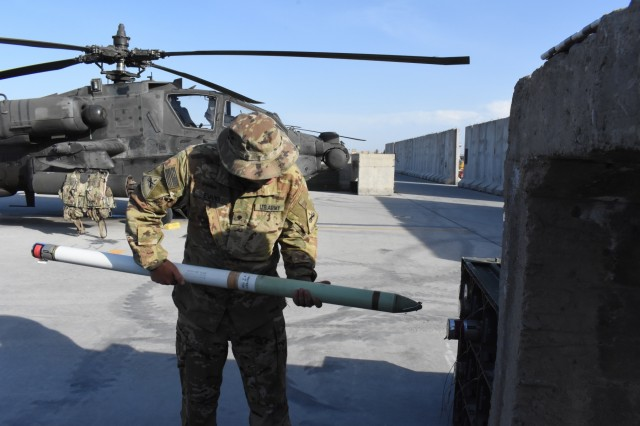 Task Force heavy Cav Soldier, Spc. Evans, takes accountability of ammunition in Afghanistan.