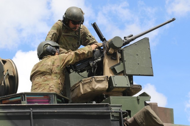 Soldier from Company B, 1st Battalion, 64th Armor Regiment, 1st Armor Brigade Combat Team, conduct maintenance on their .50-Caliber machine gun. Tank crews utilized the weapon system to engage enemy targets as part of their gunnery table five.