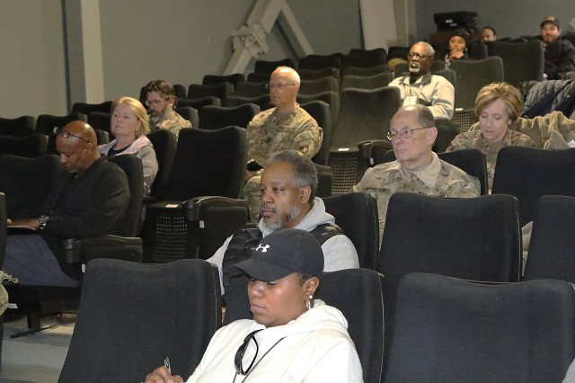 Deployed Army civilian personnel listen to a response during a town hall meeting for them at Bagram Airfield, Afghanistan, conducted by Yanir Hill, chief, Benefits, Compensation & Deployments, Office of the Assistant G-1 for Civilian Personnel. (Photo by Jon Micheal Connor, Army Public Affairs)