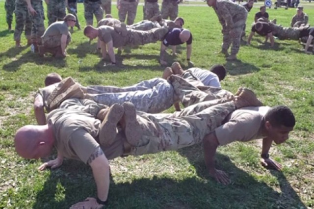 During Fort Knox's inaugural SHARP Cup Field Meet, teams competed against each other in multiple physical activities like 'Four Man stacked' pushups. Others contributed with points earned for correct answers to SHARP-related questions at the event designed to draw attention to sexual assault and build support for sexual assault survivors.