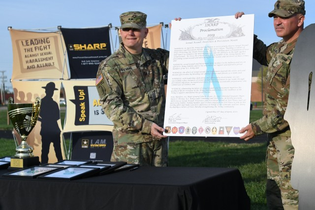 "Maj. Gen. John Evans Jr., commander of U.S. Army Cadet Command and Fort Knox and Command Sgt. Maj. Mario Terenas stand with the 2019 SHARP Proclamation they signed to begin the SHARP Cup Field Meet. Evans said the proclamation was a symbol of our Soldier determination to fight sexual assault, and he encouraged leaders ""to address teammates who start to err. Step in and do something about it."""