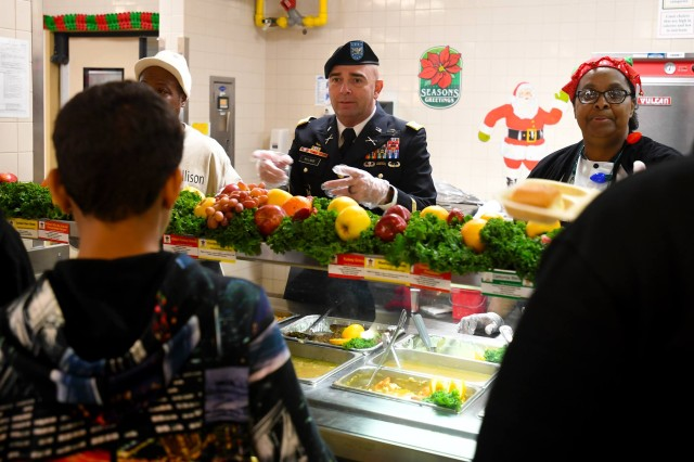 Col. Joseph McLamb, Fort Jackson's deputy commanding officer, serves Christmas meals last December to visitors at one of the installation's dining facilities.