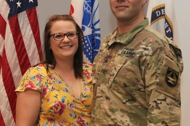 Katy Bailey was on hand to celebrate her husband, Sgt. Omar Bailey's, re-enlistment.