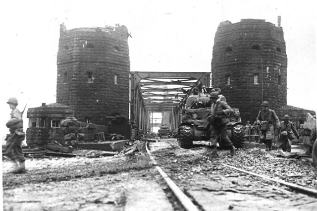U.S. tanks cross the Ludendorff Bridge 7 March 1945 at Remagen, Germany. The bridge was prepared for demolition but was still intact when the 27th Armored Infantry Battalion arrived at its location. Recognizing the importance of the bridge, battalion leaders acted on their own initiative to change their mission and seize it ten minutes before it was scheduled to be blown up by retreating German forces, ultimately enabling six divisions to cross the bridge and continue the attack before it collapsed on 17 March. (Photo by 12/Alamy Stock Photo)