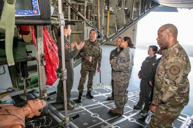 Members of the 167th Aeromedical Evacuation Squadron, 130th Airlift Wing, briefs Maj. Gen. Luis Gutiérrez, Delegate to the Inter-American Board (IADB) of Defense Organization of the United States, on aeromedical evacuation capabilities of the unit and configuration on a U.S. Air Force C-130H April 10, 2019, at McLaughlin Air National Guard Base in Charleston. Gutiérrez's visit is part of the State Partnership Program (SPP) between West Virginia and Perú which fosters interagency engagements especially in the areas of counter-insurgency, anti-terrorism, emergency preparedness, risk mitigation, and disaster response and recovery.