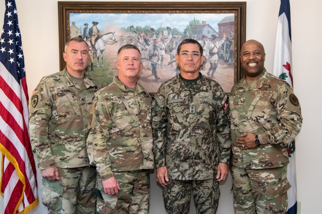 "Brig. Gen. Russell Crane, Assistant Adjutant General-Army, Maj. Gen. James Hoyer, Adjutant General of the West Virginia National Guard, and Brig. Gen. Christopher ""Mookie"" Walker, Assistant Adjutant General-Air, pose for a group photo with Maj. Gen. Luis Gutiérrez, Delegate to the Inter-American Board (IADB) of Defense Organization of the United States, during his visit to West Virginia Apr. 10, 2019. Gutiérrez's visit is part of the State Partnership Program (SPP) between West Virginia and Perú which fosters interagency engagements especially in the areas of counter-insurgency, anti-terrorism, emergency preparedness, risk mitigation, and disaster response and recovery."