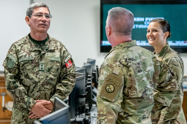 Maj. Gen. Luis Gutiérrez, Delegate to the Inter-American Board (IADB) of Defense Organization of the United States, listens to a brief on the West Virginia National Guard's domestic response and State Emergency Operations Center capabilities by Maj. Gen. James Hoyer, WVNG Adjutant General, Apr. 9, 2019 at the WVNG Joint Forces Headquarters in Charleston. Gutiérrez's visit is part of the State Partnership Program (SPP) between West Virginia and Perú which fosters interagency engagements especially in the areas of counter-insurgency, anti-terrorism, emergency preparedness, risk mitigation, and disaster response and recovery.