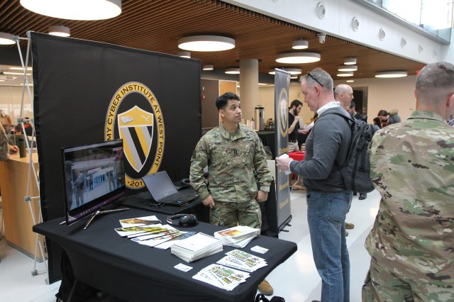 BOSTON -- Capt. Alan Adame, a scientist with the Army Cyber Institute at West Point, talks with Northeastern University students and the public about cyber and Army opportunities during Cyber Day events in the ISEC Building on the Northeastern campus, April 11, 2019. Northeastern and ACI hosted the day to bring together military and civilian subject-matter experts to discuss cyber topics, including using capture-the-flag events to identify talent; protection of critical infrastructure; augmented reality; and cyber talent and education. For more images and video of Cyber Day and Boston's Army Week events, go to https://www.dvidshub.net/unit/780MIB-C