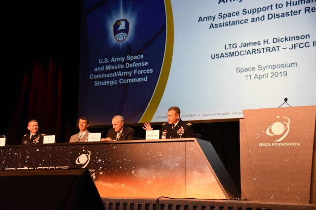 Lt. Gen. James H. Dickinson, commanding general, U.S. Army Space and Missile Defense Command/Army Forces Strategic Command, right, leads a panel during the 35th Space Symposium April 11 in Colorado Springs, Colorado. Leaders from throughout the command as well as West Point, joined Dickinson in a panel discussion focusing on how the Army's space capabilities apply to every Army and  joint force mission set, including humanitarian assistance and disaster relief. (U.S. Army photo by Dottie K. White)