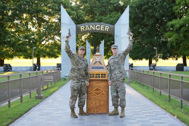 From left, Capts. Michael Rose and John Bergman of the 101st Airborne Division pose at the Ranger Monument April 15 at Fort Benning, Ga. Rose and Bergman were Team 19 during the 2019 Best Ranger Competition at Fort Benning, Ga., and won the competition.