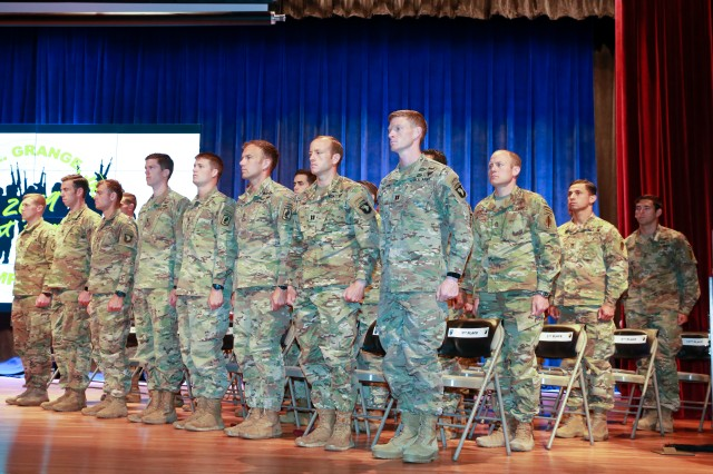 """The 16 finalist teams of the 2019 Best Ranger Competition stand on stage at the Maneuver Center of Excellence headquarters April 15 here. Capts. John Bergman and Michael Rose of the 101st Airborne Division at Fort Campbell, Ky., earned the title of """"Best Rangers"""" during an awards ceremony at the Maneuver Center of Excellence headquarters April 15 at Fort Benning. Rose is the first ranger to win three times, and Rose and Bergman are the first team members to win together twice. Bergman and Rose won together in 2014 when they were second lieutenants representing the 25th Infantry Division at Schofield Barracks, Hawaii, and Rose won again in 2017 when he represented the 75th Ranger Regiment with Master Sgt. Josh Horsager."""
