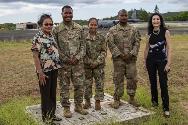 Minister of State Faustina K. Rahuher-Marugg (left), Staff Sgt. Jacob Remoket, Staff Sgt. Jessica San Nicolas, Sgt. Sloane Malchiyanged, and U.S. Ambassador to Palau Amy Hyatt, pose for a picture as Soldiers exit a C-130 Hercules on Palau International Airport, April 13, 2019, as part of Exercise Palau. The three U.S.-Palauan Soldiers are all participating during the training exercise. The exercise is part of Pacific Pathways, an annual U.S. Army Pacific (USARPAC) operation, demonstrating the U.S. Army's commitment to the Palau nation, security cooperation for a free and open Indo-Pacific. The exercise will run from the 13th - 19th, and will include several security cooperation training events as well as community and animal health outreach services at several sites including Koror, Peleliu and Angaur.