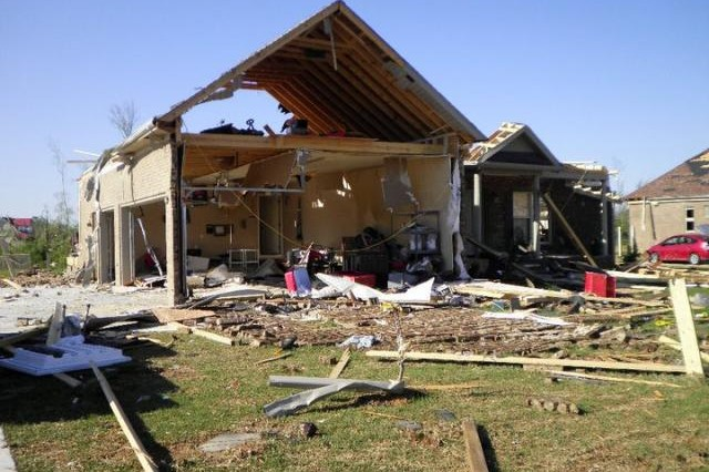 The front of Sue and Jack Tillery's house after it was struck by three destructive weather systems that roared through their Athens neighborhood on April 27, 2011. The day's record 216 tornadoes along with thunderstorms killed 348 people across the Southeast, including 238 in Alabama, and caused an estimated $11 billion in damage. Redstone Arsenal employees, retirees and veterans as well as their family members are invited to Team Redstone Protection Day April 25 where they will learn about weather awareness and safety, among other safety topics.