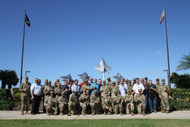 FORT SHAFTER, Hawaii -- More than 40 Pacific based munitions experts pose in front of the Bishop Point Memorial for a group photo located behind the Historic Hickam Officers Club for the first ever Pacific Theater Munitions Summit,  hosted by the 8th Theater Sustainment Command.  Apr. 4, 2019.  The summit served as a forum for the munitions community to come together to collaborate and define problems and shortcomings of facilities in the Pacific theater.