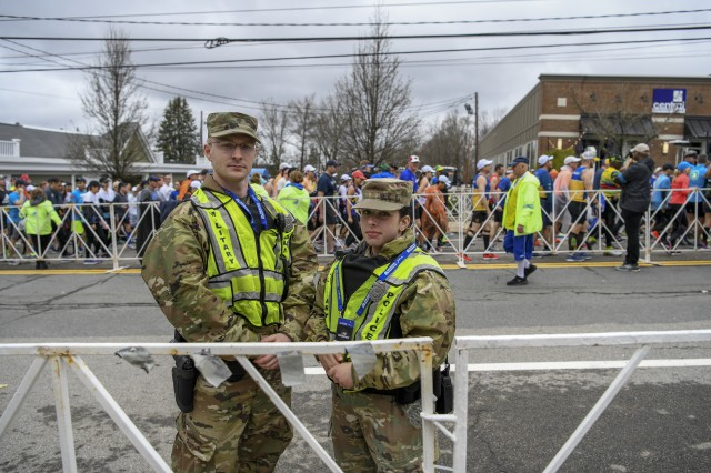 Specialist Daniel Dellisola and Private Haley MacDonald, 747 Military Police Company soldiers, support state and local law enforcement during the 123rd Boston Marathon April 15, 2019, in Hopkinton, Massachusetts. More than 500 members of the Massachusetts National Guard provided support during the marathon.