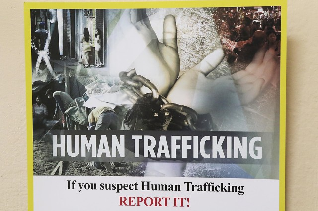 Shown is part of a DOD poster hanging in the office of Charmane Johnson, program manager for Combat Trafficking in Persons, U.S. Forces - Afghanistan and U.S. Central Command. (Photo by Jon Micheal Connor, Army Public Affairs)