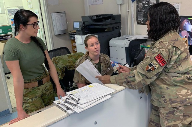 Charmane Johnson, program manager for Combat Trafficking in Persons, U.S. Forces - Afghanistan and U.S. Central Command, talks to British personnel during a CTIP battlefield circulation about human trafficking education and awareness in Kabul, Afghanistan. (Photo by Nichelle Fails, USFOR-A SAPR)