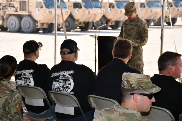 Master of ceremonies Maj. Andrew Scruggs stands at the podium against a backdrop of semi-autonomous palletized load system vehicles, which one by one were dedicated to 16 fallen Soldiers of the Army's 88 Mikes during a ceremony April 10 at the Westbrook basecamp at Fort Bliss. (U.S. Army photo by Jerome Aliotta/Released)
