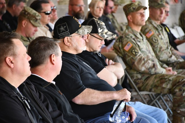 "David Muhr, center left, and his son Aaron, attend a vehicle dedication ceremony at Fort Bliss for 26-year-old son and brother Spc. Shawn ""Ox"" Muhr, a motor transport operator who was killed by an improved explosive device in Afghanistan in 2011. (U.S. Army photo by Jerome Aliotta/Released)"