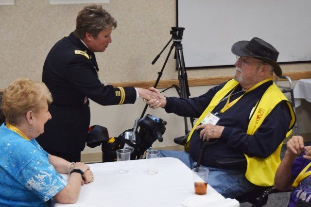 Lt. Col. Kirsten Swanson visits with one of the 28 veterans being honored by Honor Fight Southern New Mexico, dedicated to providing veterans with honor and closure.