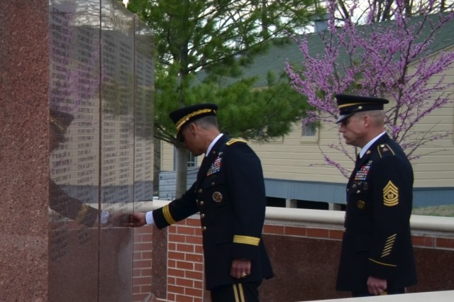 Command Sgt. Maj. Galick looks on as Brig. Gen. Robert Whittle Jr. U.S. Army Engineer School commandant, touches the inscription of Sgt. 1st Class Christopher Celiz during a Fallen Sapper Tribute April 11 at the Sapper Memorial Grove, Fort Leonard Wood, Missouri. Celiz died July 12, 2018, while serving during Operation Freedom's Sentinel.
