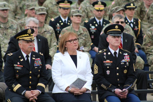 The 54th Chief of Engineers Lt. Gen. Todd Semonite, Connie Semonite and Command Sgt. Major Bradley Houston, U.S. Army Corps of Engineers, listen to remarks during the Fallen Sapper Tribute held April 11 at Sapper Memorial Grove, Fort Leonard Wood, Missouri. The event is held annually as part of Engineer Regimental Week and honors the lives and service of fallen Sappers from current and past military operations.