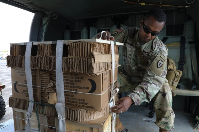 Chief Warrant Officer 3 Gregory Benson, Airdrop Systems Technician assigned to 25th Division Sustainment Brigade, partnered with the 25th Combat Aviation Brigade Soldiers to conduct aerial delivery resupply missions. They accomplished this task by using the free drop technique in support of four companies of the 2nd Battalion, 27th Infantry Regiment, 3rd Brigade Combat Team during Operation Lightning Strike field exercise.  Each free drop supplied 2-27INF, 3IBCT Soldiers with 390lbs of meals and ammunition; approximately one day worth from four UH-60 Black Hawk helicopters to two locations simultaneously. (U.S. Army Photos by Sgt. Sarah D Williams)