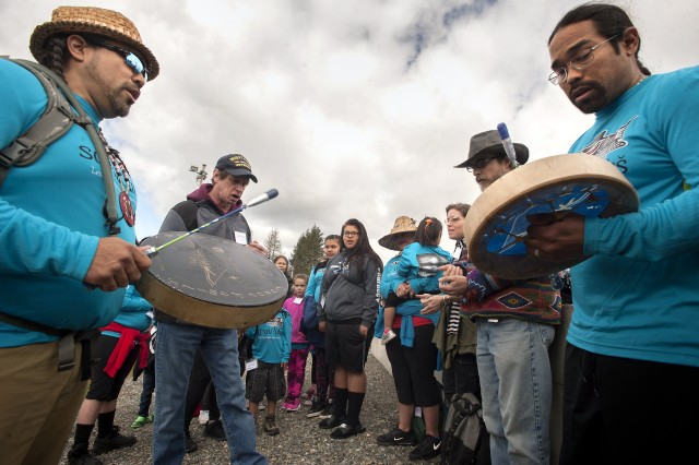Leschi tribal council member Hanford McCloud, left, leads participants in a traditional song during the opening ceremony for the ninth annual Leschi-Quiemuth Honor Walk at Range 91 on Lewis Main May 6, 2017.