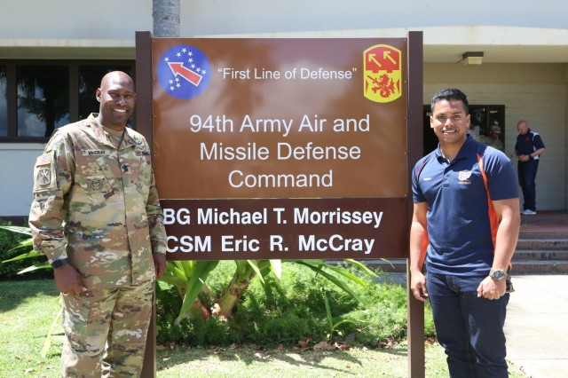 Command Sgt. Maj. Eric R. McCray (left), the Command Sergeant Major of the 94th Army Air and Missile Defense Command smiles for a picture with one his former Soldiers, Niluk Wikkramatillake (right) on March 21, 2019 at Joint Base Pearl Harbor-Hickam, Hawaii. Wikkramatillake is set to earn his commission from The University of Texas at El Paso in May 2019.