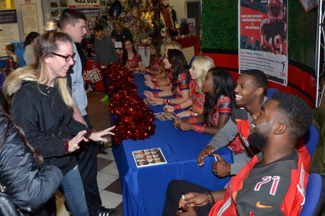 VICENZA -- The Tampa Bay Buccaneer Cheerleaders and football players visited Caserma Ederle Feb. 1, 2019, as part of a 12-day tour to several military bases in Italy and Greece. The TBBC were traveling with Armed Forces Entertainment to visit and say thank you to U.S. Service Members.