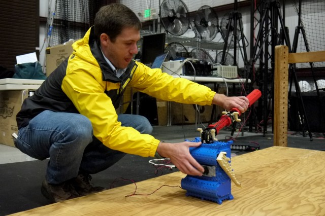 Scientific research is fraught with peril, even when working with software and robots. Researchers like Jim Dotterweich never know when the test subjects will act out or scoot too close to falling off the ramp. However, once properly in position, the test robot is able to perform self-righting maneuvers quite well.