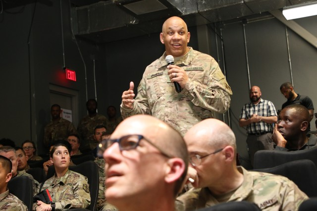 "During the question and answer session of the town hall with Lt. Gen. Todd T. Semonite, the USACE Director of Information Management, Afghanistan District Chris Brooks asks a question regarding the latest ""Semonote"" distributed to USACE personnel."