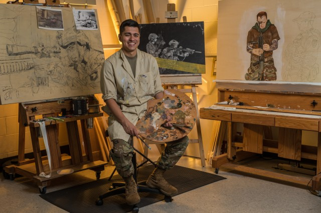 Master Sgt. Juan Munoz, the Army's artist-in-residence, sits in front of three of his working art pieces in his studio in Fort Belvoir, Va.