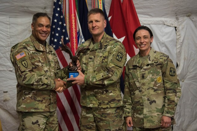 United States Army Forces Command Commander, Gen. Michael X. Garrett, stands with one of the two Army Exceptional Organization Safety Award winners; 1st Medical Bde. Commander, Col. Robert F. Howe and Command Sgt. Maj. Jennifer Redding April 10 after presenting their awards.  Soldiers and command teams from 1st Medical Brigade, 13th Expeditionary Sustainment Command, were recognized during the Fort Hood FORSCOM Safety Awards ceremony April 10. (U.S. Army photo by Sgt. 1st Class Kelvin Ringold)