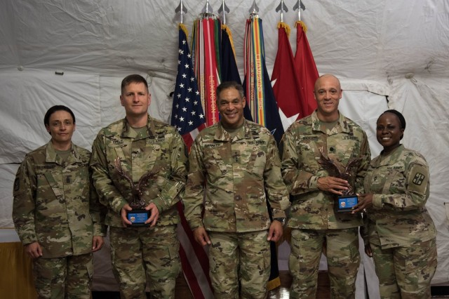 1st Medical Brigade's command team of Lt. Col. Robert F. Howe and Command Sgt. Maj. Jennifer Redding, along with 528th Hospital Command's Lt. Col. Deon Maxwell and Master Sgt. Arianna Pickens-Thomas, join United States Army Forces Command Commander, Gen. Michael X. Garrett, after being presented their awards. 1st Medical Bde. and 528th Hospital Command won the Army Exceptional Organization Safety Award in a ceremony April 10. (U.S. Army photo by Sgt. 1st Class Kelvin Ringold)