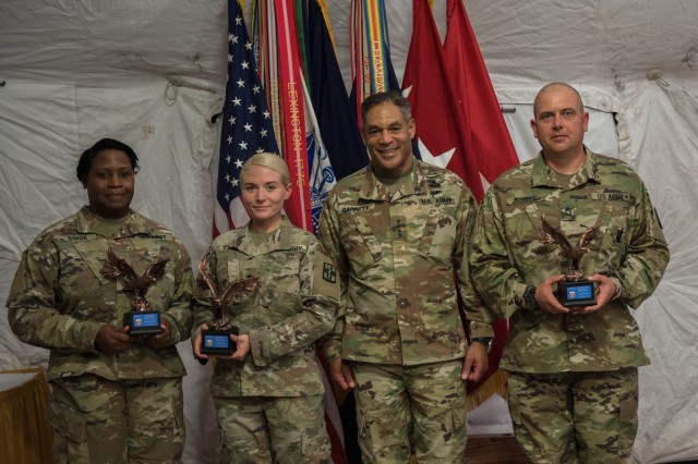 Army Individual Award for Excellence in Safety winners; Sgt. 1st Class Jason Eccles, 61st Multifunctional Medical Battalion, Maj. Denise Simon, 115th Combat Support Hospital and Spc. Kaylee Stone, 21st CSH, receive their awards from United States Army Forces Command Commander, Gen. Michael X. Garrett.  Soldiers and command teams from 1st Medical Brigade, 13th Expeditionary Sustainment Command, were recognized during the Fort Hood FORSCOM Safety Awards ceremony. (U.S. Army photo by Sgt. 1st Class Kelvin Ringold)
