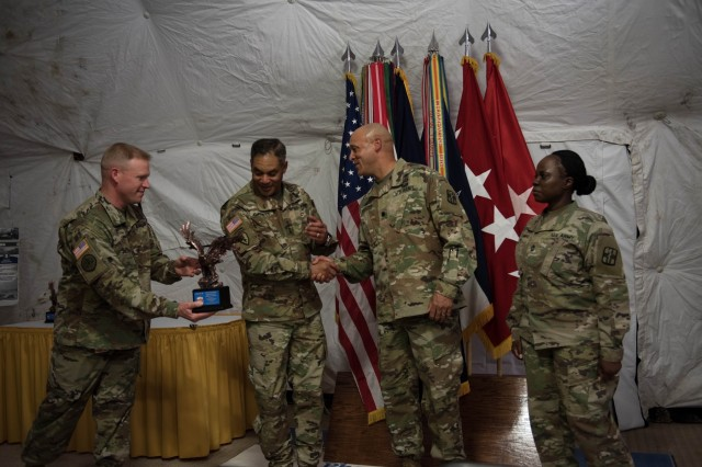 United States Army Forces Command Commander, Gen. Michael X. Garrett shakes hands before presenting 528th Hospital Command's Lt. Col. Deon Maxwell and Master Sgt. Arianna Pickens-Thomas with their FORSCOM award.  1st Medical Brigade and four units under them were recognized by FORSCOM for their safety program April 10. (U.S. Army Photos by Sgt. 1st Class Kelvin Ringold)